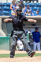 Home plate umpire Darius Ghani makes a strike call during the game against the Visalia Rawhide at LoanMart Field on May 14, 2018 in Rancho Cucamonga, California. The Rawhide defeated the Quakes 5-0.  (Donn Parris/Four Seam Images)