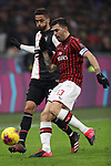 Rodrigo Bentancur of Juventus is challenged by Alessio Romagnoliof AC Milan during the Coppa Italia match at Giuseppe Meazza, Milan. Picture date: 13th February 2020. Picture credit should read: Jonathan Moscrop/Sportimage