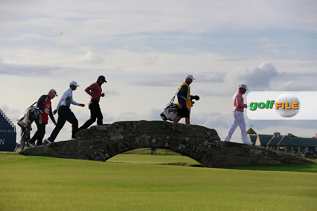 Tiger WOODS (USA) and Louis Oosthuizen (RSA) and Jason Day (AUS) during the finish of the second round on Saturday evening of the 144th Open Championship, St Andrews Old Course, St Andrews, Fife, Scotland. 18/07/2015.<br /> Picture: Golffile | Fran Caffrey<br /> <br /> <br /> All photo usage must carry mandatory copyright credit (&copy; Golffile | Fran Caffrey)