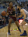 Little Rock guard Rayjon Tucker (3) is guarded by Nevada's Cody Martin in the first half of an NCAA college basketball game in Reno, Nev., Friday, Nov. 16, 2018. (AP Photo/Tom R. Smedes)