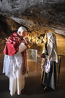 Sanctuary of Lourdes,Pope Benedict XVI prays at the Grotto of the Apparitions, also called Grotto of Massabielle, Saturday, Sept. 13, 2008, in the Sanctuary of Lourdes, southwestern France.