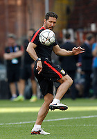 Calcio, Champions League: allenamento del Real Madrid alla vigilia della finale, allo stadio San Siro, Milano, 27 maggio 2016.<br /> Atletico Madrid's coach Diego Simeone controls the ball during a training session ahead of the final match against Real Madrid, at Milan's San Siro stadium, 27 May 2016.<br /> UPDATE IMAGES PRESS/Isabella Bonotto