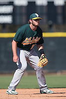 Max Muncy #16 of the Oakland Athletics during a Minor League Spring Training Game against the Los Angeles Angels at the Los Angeles Angels Spring Training Complex on March 17, 2014 in Tempe, Arizona. (Larry Goren/Four Seam Images)
