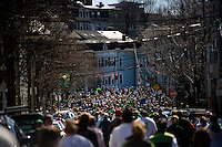 People come to the finish line of the St. Patrick's Day 5K Road Race and Walk in South Boston, Massachusetts.