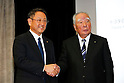 Toyota Motor Corp President and CEO Akio Toyoda, left, shakes hands with Suzuki Motor Corp Chairman and CEO Osamu Suzuki during a joint press conference in Tokyo, Japan on October 12, 2016. Japanese automakers Toyota and Suzuki announced they have agreed to start exploring their business partnership to strengthen collaboration in fields of environment, safety, and information technology.  (Photo by AFLO)