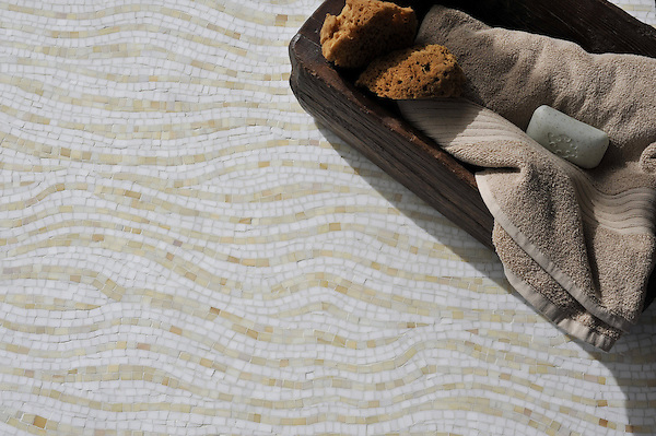 Dune, a Sea Glass™ mosaic shown in Absolute White and Agate, is part of the Metamorphosis Collection by Sara Baldwin for New Ravenna Mosaics.