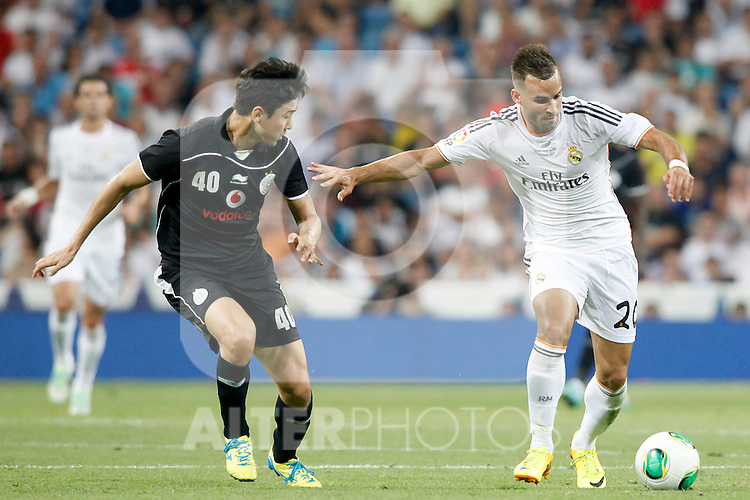 Real Madrid's Jese Rodriguez (r) and Al Sadd's Lee Jong Soo during Santiago Bernabeu Trophy.August 22,2013. (ALTERPHOTOS/Victor Blanco)