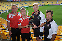 From left, Swans coach John Longmire, Swans captain Kieren Jack, Saints captain Nick Riewoldt and Saints coach Scott Watters pose with the Simpson-Henderson Trophy during the St Kilda Saints v Sydney Swans press conference at the Aotea Lounge, Westpac Stadium, Wellington, New Zealand on Wednesday, 24 May 2013. Photo: Dave Lintott / lintottphoto.co.nz