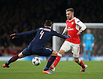 Arsenal's Aaron Ramsey tussles with PSG's Gregorz Krychowiak during the Champions League group A match at the Emirates Stadium, London. Picture date November 23rd, 2016 Pic David Klein/Sportimage
