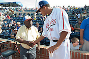 Chris Archer speaks with Thomas Clark, of the Durham Rams, one of original Negro League players at the Durham Bulls' field Sunday August 5th 2012.