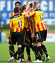 Partick's Stephen O'Donnell is congratulated after he scores their first goal.