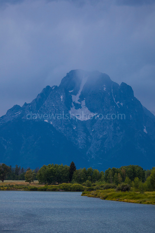 Mount Moran, Grand Teton National Park, Wyoming seen during a thunderstorm. Mt Moran is 3842m high, with several glaciers visible.