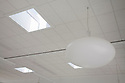A skylight near an energy efficient ceiling light, turned off, in Integrated Design Associates office in San Jose, California, USA