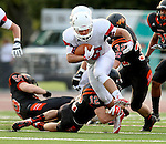 SIOUX FALLS, SD - AUGUST  28: yler Hintz #26 from Brandon Valley gets tripped up by Jack Schelhaas #12 from Washington in the first half of their game Friday night at Howard Wood Field. (Photo by Dave Eggen/Inertia)
