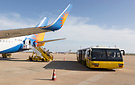 Jet2 package holiday plane passengers disembarking at the airport Faro, Algarve, Portugal with extra wide transport bus
