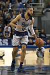Nevada forward Cody Martin (11) brings the ball up the floor against Little Rock in the second half of an NCAA college basketball game in Reno, Nev., Friday, Nov. 16, 2018. (AP Photo/Tom R. Smedes)