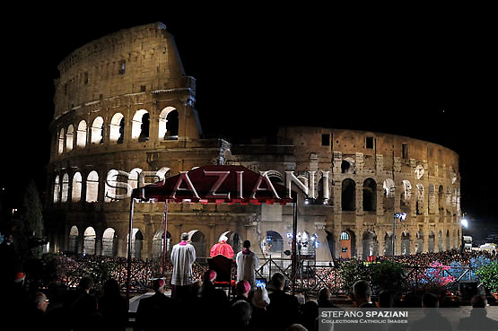 Pope Benedict XVI holds the wooden cross during the Via Crucis (Way of the Cross) torchlight procession on Good Friday in front of the Colosseum in Rome, Friday, April 2, 2010.The evening Via Crucis procession at the ancient Colosseum amphitheater is a Rome tradition that draws a large crowd of faithful, including many of the pilgrims who flock to the Italian capital for Holy Week ceremonies before Easter SundayVia Crucis;