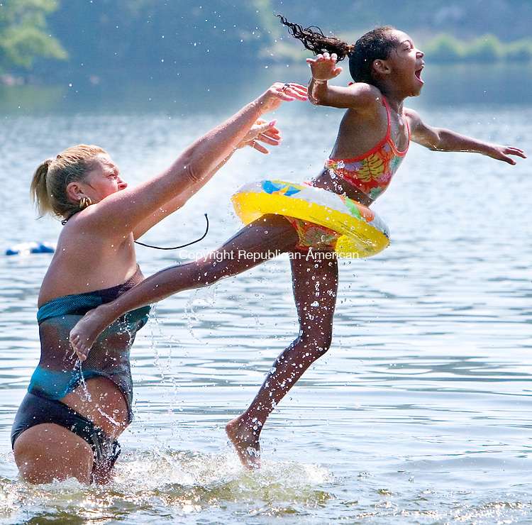 WATERBURY, CT. 26 June 2007-062607SV05--Virginia Jones of Waterbury tosses Nia Mone Atwood, 6, of Waterbury into the water while swimming at Lakewood Park in Waterbury Tuesday. Area temperatures were well into the 90's and humid.<br /> Steven Valenti Republican-American