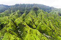 An aerial view of a green mountain range on Kaua'i