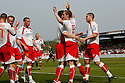 David Bridges of Stevenage Borough celebrates scoring the first goal with team-mates during the Blue Square Premier match between Stevenage Borough and York City at the Lamex Stadium, Broadhall Way, Stevenage on Saturday 24th April, 2010..© Kevin Coleman 2010 ..