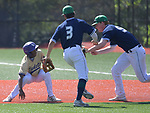 CBC's Bryce Broyles (left) was tagged out on a rundown between first and second base as Marquette's Jake Hansen (center)) and Connor Throneberry teamed up on the play. Marquette defeated CBC in the Class 5 baseball sectional played at Vianney High Schoo lin St. Louis, MO on Wednesday May 22, 2019.<br /> Tim Vizer/Special to STLhighschoolsports.com