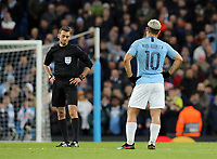 Manchester City's Sergio Aguero looks to Referee Clement Turpin as he waits of the VAR review after scoring his side's second goal<br /> <br /> Photographer Rich Linley/CameraSport<br /> <br /> UEFA Champions League Round of 16 Second Leg - Manchester City v FC Schalke 04 - Tuesday 12th March 2019 - The Etihad - Manchester<br />  <br /> World Copyright © 2018 CameraSport. All rights reserved. 43 Linden Ave. Countesthorpe. Leicester. England. LE8 5PG - Tel: +44 (0) 116 277 4147 - admin@camerasport.com - www.camerasport.com