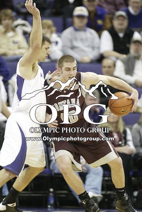 28 December 2008:  Montana's #40 Klye Sharp looks for an opening to the basket as Washington's #40 Jon Brockman puts the pressure on at the Bank of America Arena at Hec Edmundson Pavilion in Seattle, WA.  Washington won 75-53 over Montana.