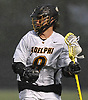 Gordon Purdie, Jr. #9 of Adelphi University carries downfield during a rain-filled first round game against Pace in the NCAA Division II Tournament at Motamed Field in Garden City, NY on Saturday, May 13, 2017.