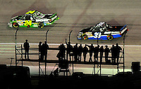 Nov. 6, 2009; Fort Worth, TX, USA; NASCAR Camping World Truck Series fans watch from the infield as trucks race by during the WinStar World Casino 350 at the Texas Motor Speedway. Mandatory Credit: Mark J. Rebilas-