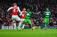 Bafetibi Gomis of Swansea City makes a run at goal during the Barclays Premier League match between Arsenal and Swansea City at the Emirates Stadium, London, UK, Wednesday 02 March 2016