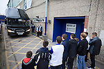 Tranmere Rovers 0 Stoke City 2, 25/09/2013. Prenton Park, Captial One Cup Third Round. Young fans watching the visiting team bus pulling up outside the players' entrance at Prenton Park before Tranmere Rovers host Stoke City in a Capital One Cup third round match. The Capital One cup was formerly known as the League Cup and was competed for by all 92 English Premier League and Football League clubs. Visitors Stoke City won the match 2-0, watched by a crowd of 5,559 spectators. Photo by Colin McPherson.