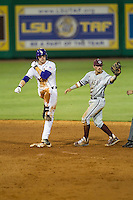 Texas A&M Aggies shortstop Blake Allemand (1) shows the ball to the umpires after taking out LSU Tigers baserunner Jake Fraley (23) in the 9th inning of the Southeastern Conference baseball game on April 23, 2015 at Alex Box Stadium in Baton Rouge, Louisiana. LSU defeated Texas A&M 4-3. (Andrew Woolley/Four Seam Images)