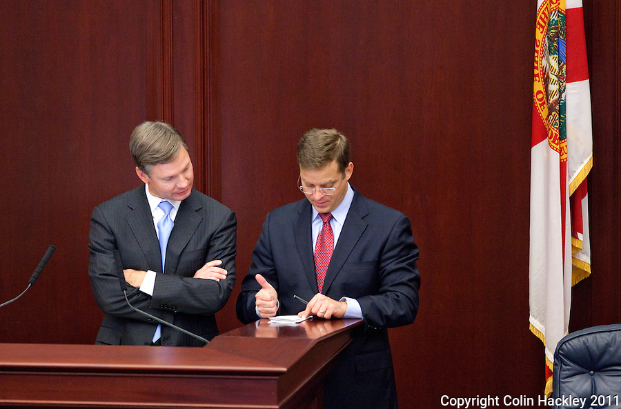 TALLAHASSEE, FLA. 5/6/11-SESSIONEND050611 CH-House Speaker Dean Cannon, R-Winter Park, left, and Rep. Carlos Lopez-Cantera, R-Miami, run down a check list during the last day of the regularly scheduled session, Friday at the Capitol in Tallahassee..COLIN HACKLEY PHOTO