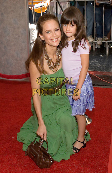 "KELLY PRESTON & DAUGHTER (ELLA BLEU TRAVOLTA).Walt Disney Pictures' World Premiere of ""Sky High"" held at the El Capitan Theatre, Hollywood, California..July 24th, 2005  .Photo Credit: Zach Lipp/AdMedia.full length mother family green dress brown belt blue purple skirts necklace brown purse bag kneeling crouching.www.capitalpictures.com.sales@capitalpictures.com.© Capital Pictures."
