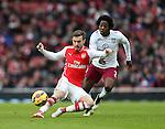 Arsenal's Aaron Ramsey tussles with Aston Villa's Carlos Sanchez<br /> <br /> Barclays Premier League - Arsenal vs Aston Villa - Emirates Stadium  - England - 1st February 2015 - Picture David Klein/Sportimage