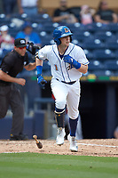 Jake Cronenworth (1) of the Durham Bulls hustles down the first base line against the Columbus Clippers at Durham Bulls Athletic Park on June 1, 2019 in Durham, North Carolina. The Bulls defeated the Clippers 11-5 in game one of a doubleheader. (Brian Westerholt/Four Seam Images)