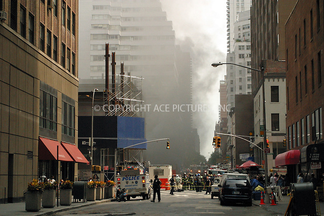 Fire on Lexington Avenue at 59th Street at the construction site of the future office building. New York, August 22, 2002. ..Please byline: Alecsey Boldeskul/NY Photo Press.   ..*PAY-PER-USE*      ....NY Photo Press:  ..phone (646) 267-6913;   ..e-mail: info@nyphotopress.com