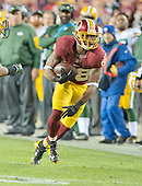 Washington Redskins wide receiver Pierre Garcon (88) carries the ball after a first quarter reception against the Green Bay Packers in an NFC Wild Card game at FedEx Field in Landover, Maryland on Sunday, January 10, 2016.  The Packers won the game 35 - 18.<br /> Credit: Ron Sachs / CNP