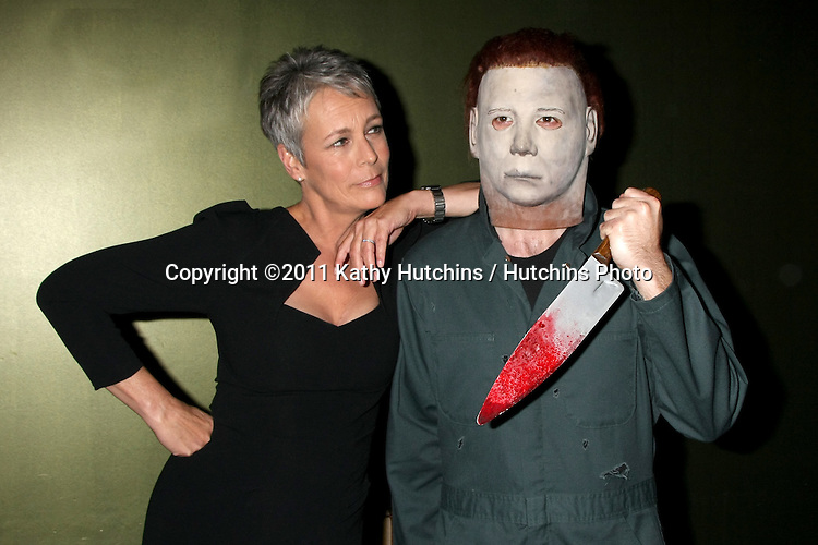 "LOS ANGELES - OCT 30:  Jamie Lee Curtis & ""Michael Myers"" Costumed Guest at the sCare Foundation Halloween Launch Benefit at Conga Room @ LA Live on October 30, 2011 in Los Angeles, CA"