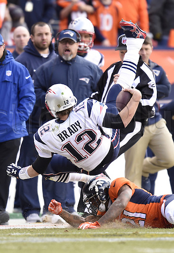 24.01.2016. Denver, Colorado, USA. The NFL AFC Championship American Football match. Broncos cornerback Aqib Talib knocks Patriots quarterback Tom Brady off his feet after Brady scrambled for a first down during the second quarter of the AFC Championship game on Sunday