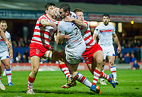 Picture by Allan McKenzie/SWpix.com - 17/04/2015 - Rugby League - Ladbrokes Challenge Cup - Wakefield Trinity Wildcats v Halifax RLFC - Rapid Solicitors Stadium, Wakefield, England - Wakefield's Ian Kirke forces his way through Halifax's tacklers to score.