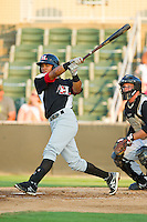 Luis Marte (3) of the Hickory Crawdads follows through on his swing against the Kannapolis Intimidators at CMC-Northeast Stadium on July 26, 2013 in Kannapolis, North Carolina.  The Intimidators defeated the Crawdads 2-1.  (Brian Westerholt/Four Seam Images)