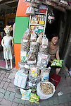 Hanoi, Vietnam, A women sits at her street stall selling dried Chinese herbal medicines as a mannequin stands watching. photo taken July 2008.