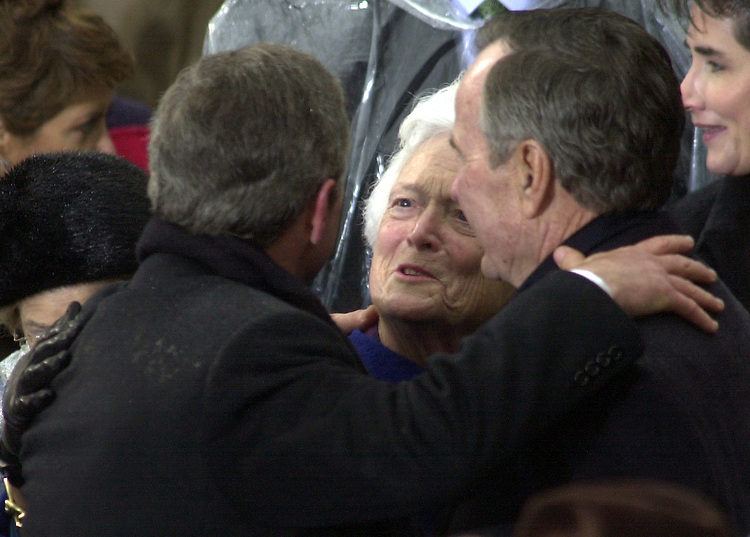 President George W. Bush hugs his Dad Former President George Bush Senior during the 43rd Inauguration on the West Front of the U.S. Capitol.