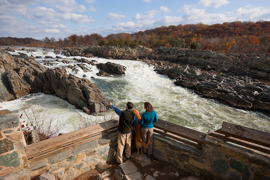 At Great Falls National Park, the Potomac River builds up speed and force as it falls over a series of steep, jagged rocks and flows through the narrow Mather Gorge.  Great Falls Park is 800-acre park 15 miles west of the Nation's Capital..
