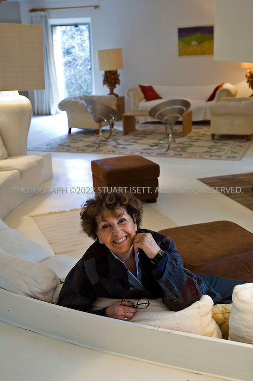 3/11/2006--St. Pierre de Vassols, France..Designer Maria Pergay sitting in the living room of her summer home of  just outside Avignon in the south of France. Pergay was born in Moldavie, Russia in 1930 and emigrated to Paris in 1937. Over Pergay?s 50-plus-year career, her objects, furniture and decor have brought her a following that included Salvador Dali, Pierre Cardin and King Fahd of Saudi Arabia, but her work has only recently gained recognition among design collectors, curators and aficionados...Photograph By Stuart Isett.All photographs ©2006 Stuart Isett.All rights reserved.