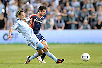 Graham Zusi Sporting KC midfielder fights for the ball with Benny Fellhaber (22) New England... Sporting Kansas City defeated New England Revolution 3-0 at LIVESTRONG Sporting Park, Kansas City, Kansas.