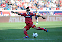 Chicago midfielder Marco Pappa (16) takes a shot on goal.  The Chicago Fire defeated the New York Red Bulls 3-1 at Toyota Park in Bridgeview, IL on June 17, 2012.