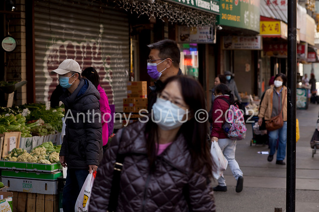New York, New York<br /> March 18, 2020<br /> 12:59 PM<br /> <br /> Manhattan under coronavirus pandemic. <br /> <br /> Shoppers wearing face mask and gloves fearing the spread of the virus in downtown Manhattan.