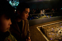 "People look at the ""Mass Grave of 10,000 Corpses"" in the Memorial Hall of the Nanjing Massacre now sits in Nanjing, China, on Thursday, Dec. 13, 2007. After two years of renovations, the Memorial Hall of the Nanjing Massacre reopened to the public on Dec. 13, 2007, the 70th anniversary of the 6-week massacre by Japanese troops that started Dec. 13, 1937 and claimed more than 300,000 lives.  The commemoration comes amid renewed controversy about the accuracy of historical accounts of the massacre.  The massacre is also known as ""The Rape of Nanking."""